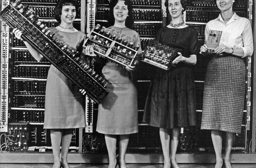 Parts from four early computers, 1962. From left to right: ENIAC board, EDVAC board, ORDVAC board, and BRLESC-I board, showing the trend toward miniaturization.